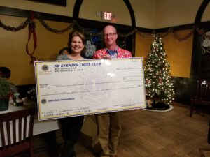 President Tom Matschek presents our donation for the Crisis Center to Executive Director Stacy Hill