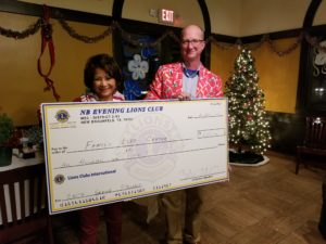 President Tom Matchek presents our donation for the Family Life Center to Kay Scott, Executive Director