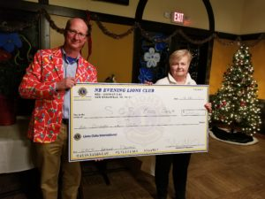 President Tom Matschek presents our donation for the Food Bank to Sandy Buck, President